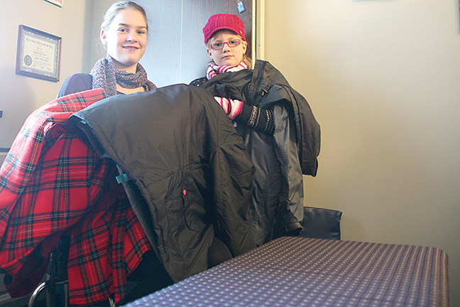Jade Hansen (left) along with her sister and family are collecting coats and warm clothing for those less fortunate in the Comox Valley Nov. 30.— Image Credit: Erin Haluschak